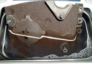 One end of the case was placed into Branson Model 2510 ultrasonic cleaner filled with eOx® AeroTech 2000